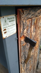 My favorite touch - Hubs made a handle for the outhouse with an axe he found inside.